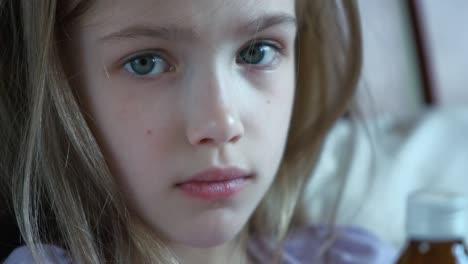 Closeup-Portrait-Child-Wich-Holding-A-Bottle-Of-Pills