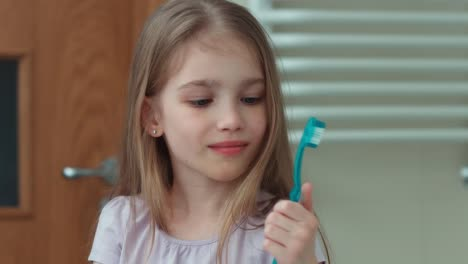 Closeup-Portrait-Girl-7-Years-Old-Brushing-Her-Teeth-With-A-Toothbrush