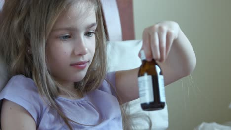 Closeup-Portrait-Sick-Niño-Girl-7-Years-Old-Takes-Vitamins-Without-Asking