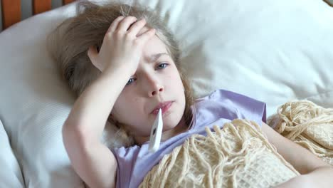 Closeup-Portrait-Sick-Girl-7-Years-Old-Lying-On-A-Bed-With-Thermometer