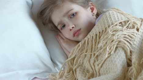 Closeup-Portrait-Sick-Girl-7-Years-Old-Coughing-Girl-Lying-On-A-Bed
