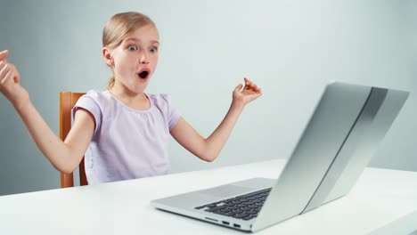 Crazy-Child-Girl-Something-Typing-In-Laptop-And-Laughing-Thumbs-Up-Ok