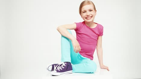 Cute-Girl-7-8-Years-Looking-And-Laughing-At-Camera-On-The-White-Background