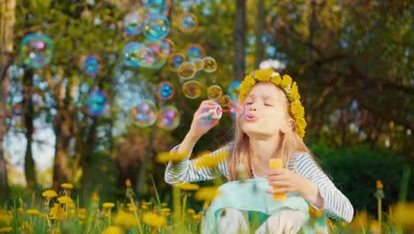 Cute-Girl-7-8-Years-Old-Smiling-And-Blowing-Soap-Bubbles-In-The-Park
