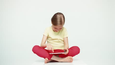Cute-Girl-7-8-Years-Old-Using-Tablet-PC-On-White-Background-Thumb-Up-Ok