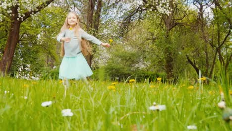 Cute-Girl-7-8-Years-Old-With-Blond-Long-Hair-Holding-Two-Dandelions-And-Spinning