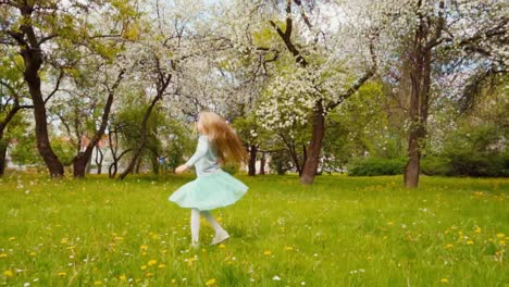 Cute-Girl-7-8-Years-Old-With-Blond-Long-Hair-Spinning-In-The-Park-Slow-Motion