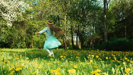 Cute-Girl-7-8-Years-Old-With-Wreath-Of-Dandelions-On-The-Head-Spinning
