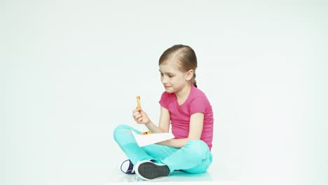 Cute-Girl-Child-7-8-Years-Eating-Potatoes-On-The-White-Background