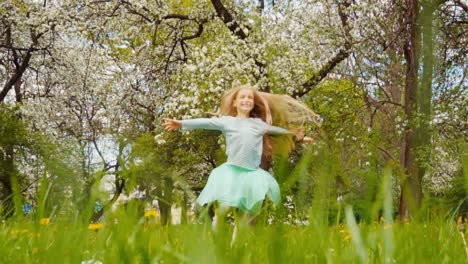 Cute-Girl-Child-7-8-Years-Old-With-Blond-Hair-Spinning-In-The-Park-In-The-Spring