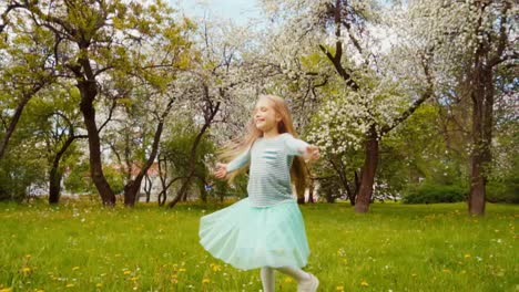 Cute-Girl-Child-7-8-Years-Old-With-Blond-Long-Hair-Spinning-In-The-Park