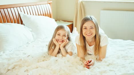 Cute-Happy-Girls-Playing-With-Fluff-And-Feathers