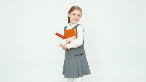 Cute-Happy-Schoolgirl-Child-7-8-Years-On-White-Background-Hugging-Books