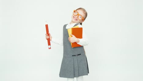 Cute-Happy-Schoolgirl-Child-7-8-Years-On-White-Background-Whirling