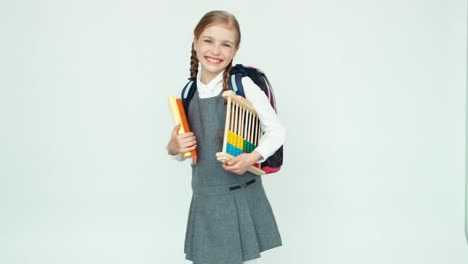 Cute-Happy-Schoolgirl-Child-7-8-Years-With-Backpack-Holding-Abacus-And-Books