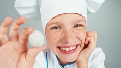 Extreme-Close-Up-Portrait-Chef-Cook-Holds-Playing-With-Quail-Egg
