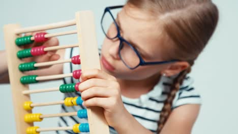 Extreme-Close-Up-Portrait-Girl-7-8-Years-Old-Using-Abacus