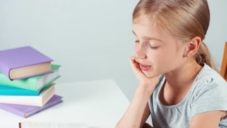 Extreme-Close-Up-Portrait-Student-Girl-Child-7-8-Years-Reading-Book-And-Smiling