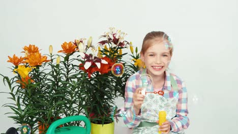 Flowergirl-Child-Blowing-Soap-Bubbles-At-Camera-And-Smiling-With-Teeth