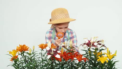 Flowergirl-Child-Using-Magnifier-Looking-At-Flowers-And-Smiling-With-Teeth