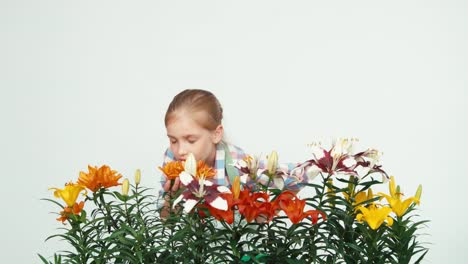 Flowergirl-Sniffing-Flowers-And-Smiling-At-Camera