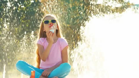 Fountain-Child-Is-Emotional-Girl-Blowing-Soap-Bubbles-Near-Fountain