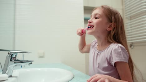Girl-7-Years-Old-Brushing-Her-Teeth-In-A-Bathroom