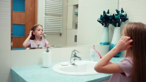 Girl-7-Years-Old-Brushing-Her-Teeth-In-The-Bathroom-Standing