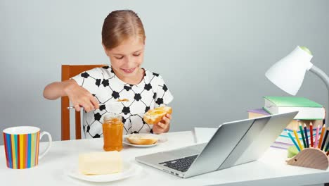 Girl-7-8-Years-Applying-Jam-To-Bread-With-Butter-Sitting-At-The-Table