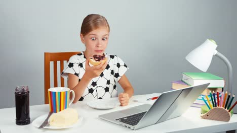 Girl-7-8-Years-Eating-Bread-With-Jam-Butter-Sitting-At-The-Table-Isolated