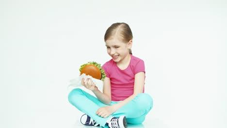 Girl-7-8-Years-Holding-Burger-Thumb-Up-Ok