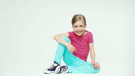 Girl-7-8-Years-Laughing-At-Camera-On-White-Background-Thumb-Up-Ok