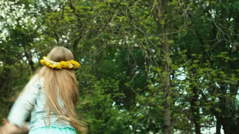 Girl-7-8-Years-Old-Dancing-On-The-Glade-Of-Dandelions