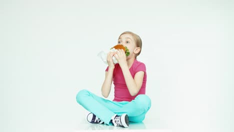 Girl-7-8-Years-Old-Eating-Burger-And-Laughing-At-Camera-On-The-White-Background