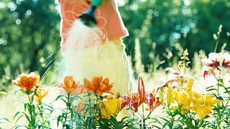 Girl-7-8-Years-Old-Holding-Watering-Can-For-Flowers-And-Watering-Flowers