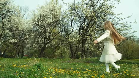 Girl-78-Years-Old-In-Coat-Spinning-Against-The-Backdrop-Of-Flowering-Trees