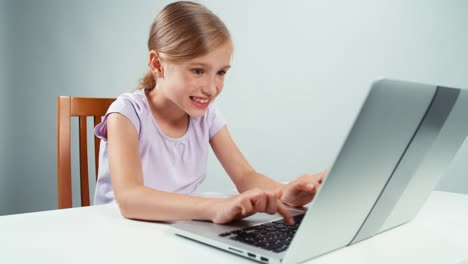 Girl-using-laptop-and-quickly-closes-it