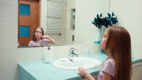 Girl-8-Years-Old-Brushing-Her-Teeth-In-The-Bathroom-Standing