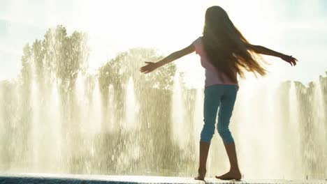 Girl-Child-7-8-Years-In-Sunglasses-Spinning-On-Fountain-Background