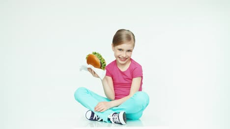 Girl-Child-7-8-Years-Old-Holding-Burger-And-Child-Giving-The-Viewer-A-Food
