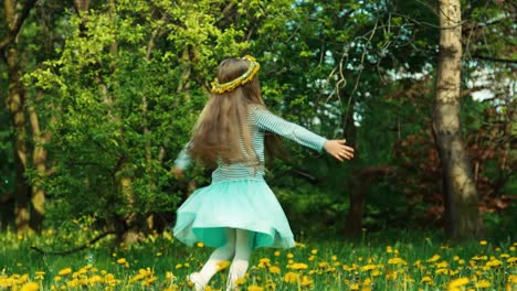 Girl-Child-7-8-Years-Old-Spinning-On-The-Glade-Of-Dandelions-In-The-Soap-Bubbles