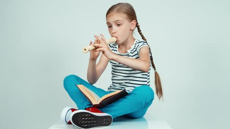 Girl-Playing-The-Flute
