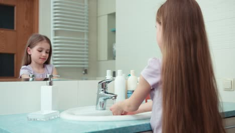 Girl-Preening-Before-The-Mirror-In-The-Bathroom-Child-Washing-Hands