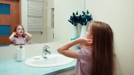 Girl-Preening-Child-7-Years-Old-Standing-In-A-Bathroom-Panning