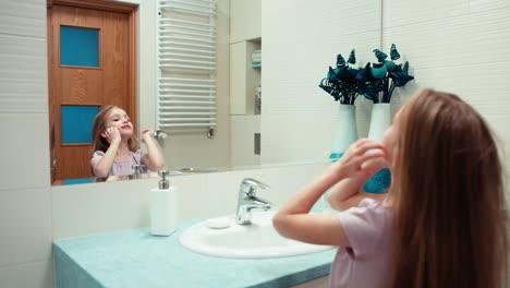 Girl-Preening-Niño-7-Years-Old-Standing-In-A-Bathroom