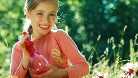 Girl-watering-her-flowers-in-the-garden-2