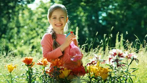 Girl-Sprinkling-Her-Flowers-In-The-Garden