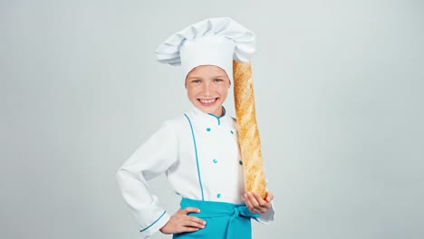 Happy-Baker-Girl-7-8-Years-Child-Holds-Bread-Baguette-And-Gives-You-It