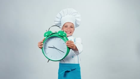 Happy-Chef-Cook-Child-7-8-Years-Holding-Alarm-Clock-And-Standing-Isolated