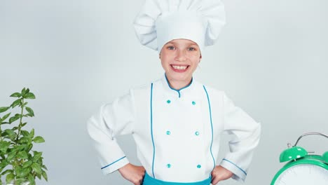 Happy-Chef-Cook-Girl-Child-7-8-Years-Old-Smiling-At-Camera-Isolated-On-White